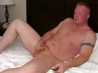 blonde homosexual guy jerks off his chubby shaft