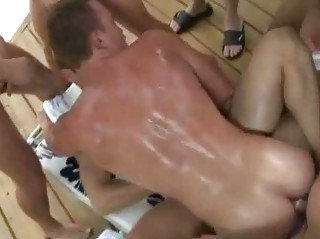 a gay porn pool side male orgy