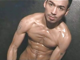 oriental muscled homosexual boy with lotion