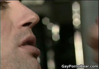 homo dude sucks schlong through a gloryhole