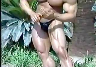 bodybuilder oiling himself